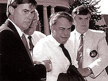 Jim Bakker being taken away