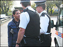 Black man with policemen